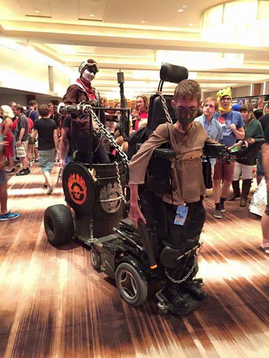 Kid with disability uses it to his advantage as a mad max cosplay