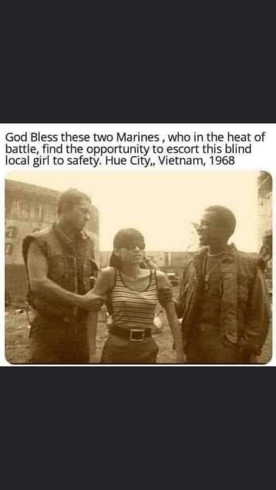 God Bless these two Marines , who m the heat of battle, find the opponunuty to escort this blind local girl to safety. Hue City,, Vietnam] 1968