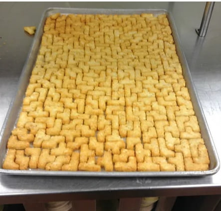 """""""Puzzle potato"""" lined up in a tray"""