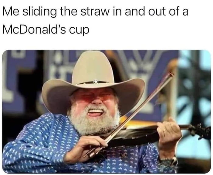 Me sliding the straw in and out of a McDonald's cup