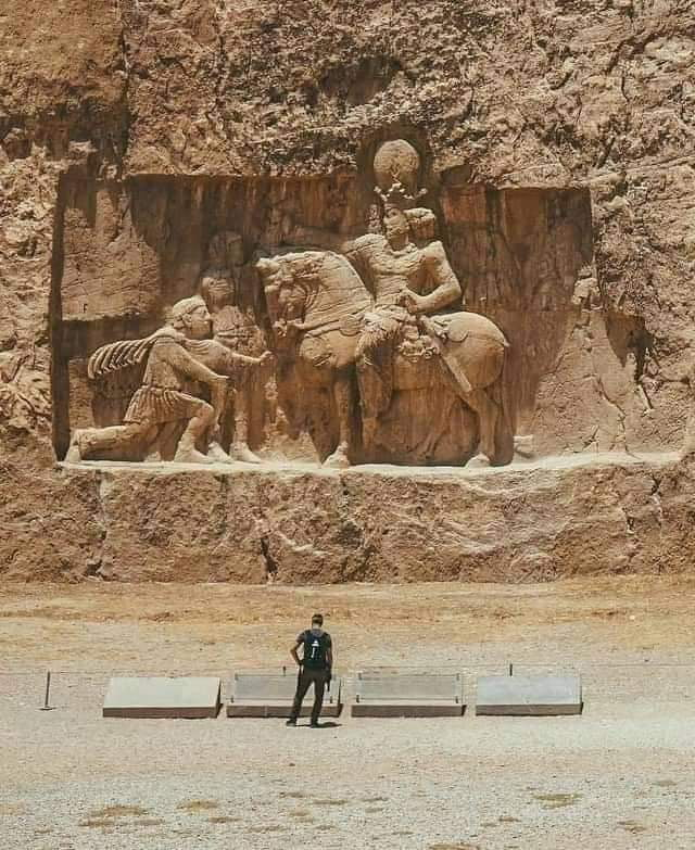 Mountain carving of Emperor of Rome Valerian kneeling in front of Iranian King Shapur I (260 AD). Located in Pars Province, Iran