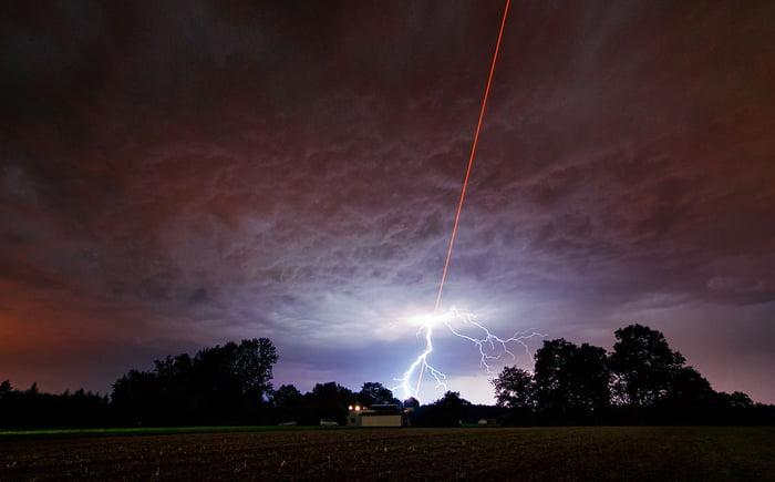 ESO was testing the Wendelstein laser guide star unit (Germany) by shooting a powerful laser beam into the atmosphere as one of the region's intense summer thunderstorms was approaching
