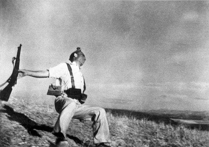 Robert Capa | The Falling Soldier | 1936. Capa's image of a Spanish militiaman being shot was taken without him ever looking through his viewfinder. Captured by holding his camera above his head while in the trenches this image took war photography to a different level.