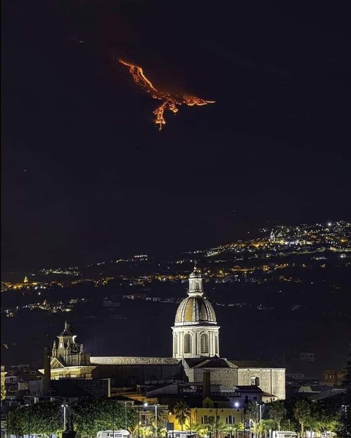Eruption on Mount Etna gives the illusion of a Phoenix in the sky