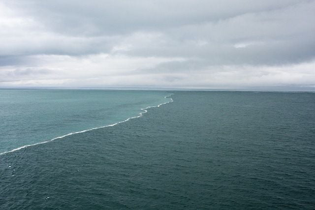 The Baltic and North sea meet in the resort town of Skagen, North of Denmark the reason why the two opposing tides cant merge is the difference of densities